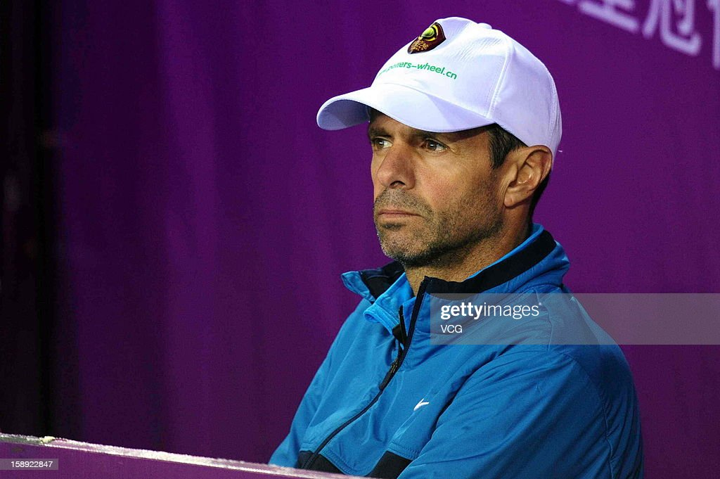 Carlos Rodriguez coach of Li Na of China watches as she plays Bojana Jovanovski of Serbia during day four of the Shenzhen Open at the Shenzhen Luohu...