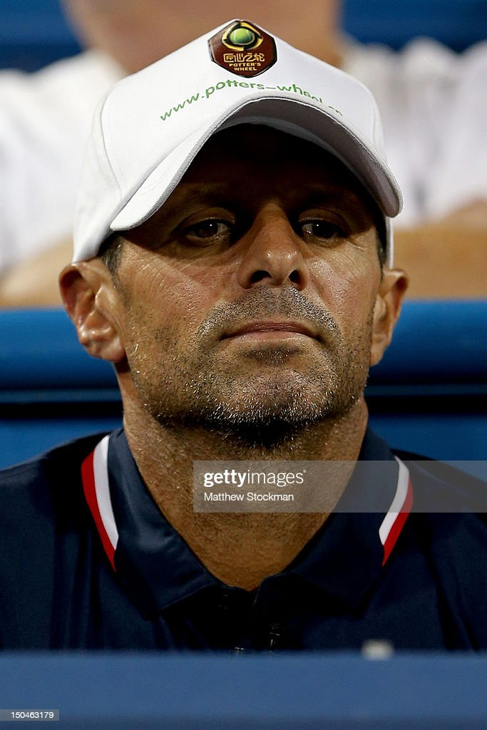 Carlos Rodriguez coach of Li Na of China watches as she plays Venus Williams during the semifinals of the Western Southern Open at the Lindner Family...