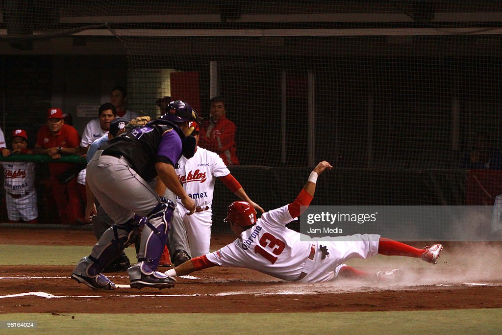 Carlos Rodriguez of Dorados and Oscar Robles of Red Devils during their match as part of the 2010 Baseball Mexican League Tournament at Sol Stadium...