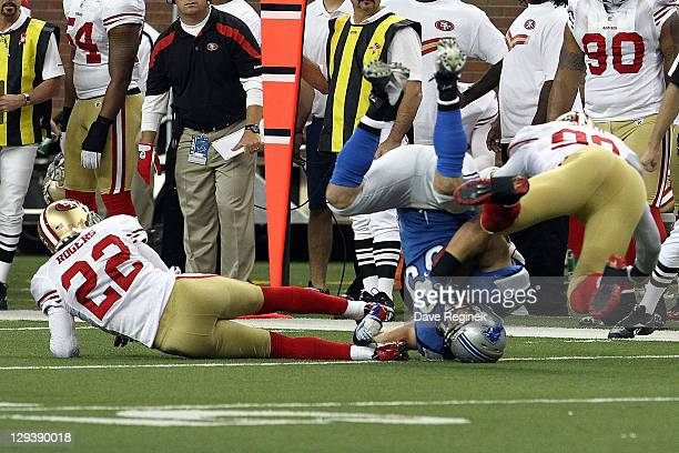 Carlos Rogers and Aldon Smith of the San Francisco 49ers team up on a tackle to Will Heller of the Detroit Lions during a NFL game at Ford Field on...