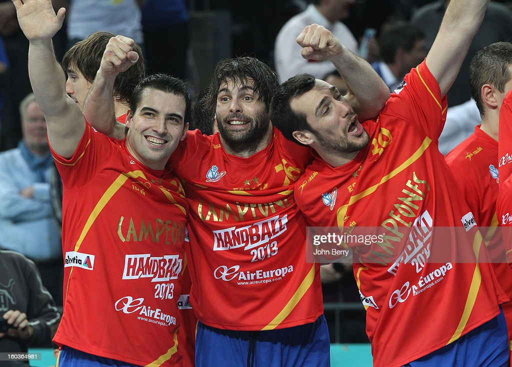 Carlos Ruesga, Antonio Garc'a, Gedeon Guardiola of Spain celebrate their victory and their gold medal after the Men's Handball World Championship 2013 final match between Spain and Denmark at Palau Sant Jordi on January 27, 2013 in Barcelona, Spain.