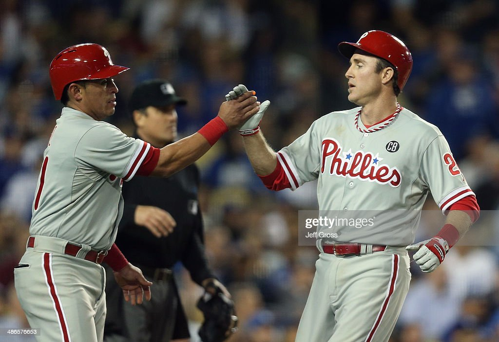 Carlos Ruiz (L) #51 and <a gi-track='captionPersonalityLinkClicked' href=/galleries/search?phrase=Chase+Utley&family=editorial&specificpeople=161391 ng-click='$event.stopPropagation()'>Chase Utley</a> #26 of the Philadelphia Phillies congratulate one another after scoring runs in the fifth inning against the Los Angeles Dodgers at Dodger Stadium on April 24, 2014 in Los Angeles, California.