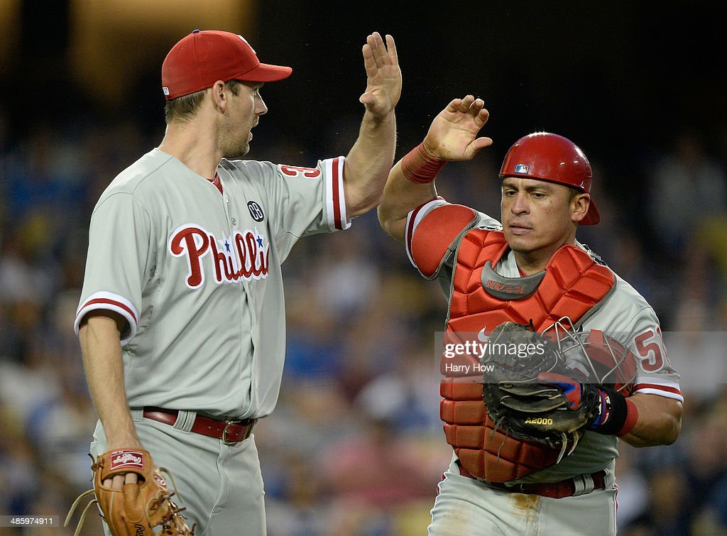 Carlos Ruiz #51 and <a gi-track='captionPersonalityLinkClicked' href=/galleries/search?phrase=Cliff+Lee&family=editorial&specificpeople=218092 ng-click='$event.stopPropagation()'>Cliff Lee</a> #33 of the Philadelphia Phillies celebrate the out of Yasiel Puig #66 of the Los Angeles Dodgers attempting to score during the first inning at Dodger Stadium on April 21, 2014 in Los Angeles, California.