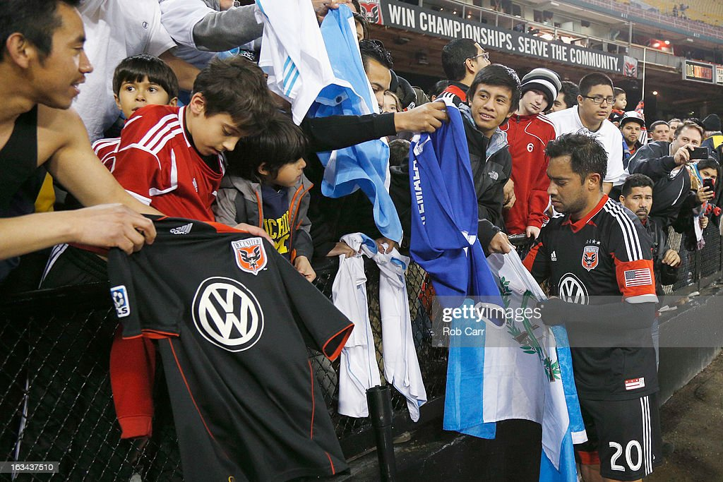 Carlos Ruiz #20 of D.C. United signs autographs following their 1-0 win over Real Salt Lake at RFK Stadium on March 9, 2013 in Washington, DC.
