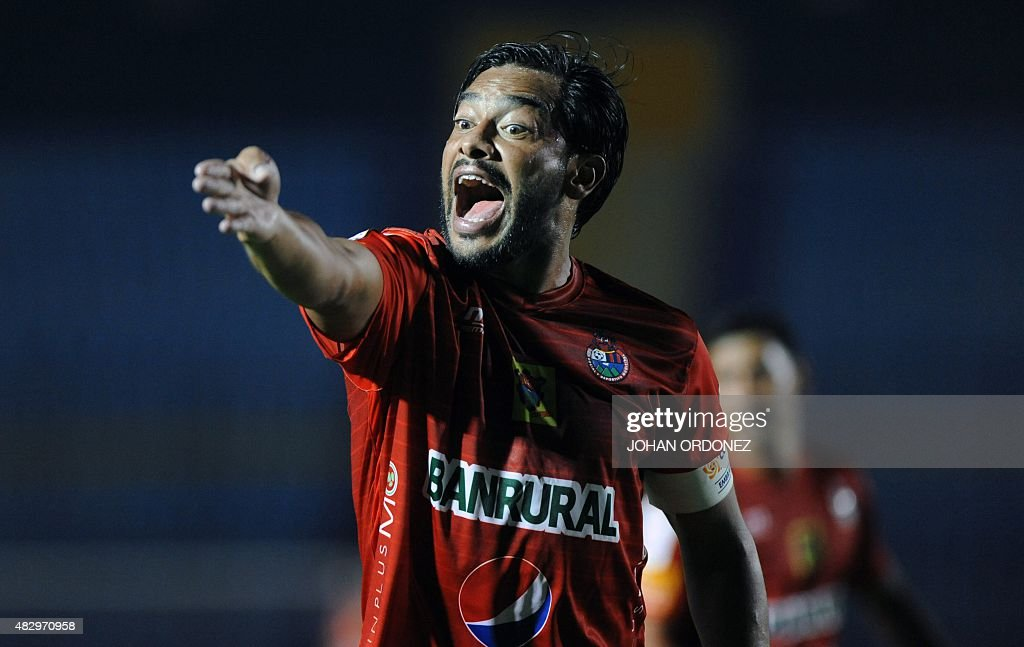 Carlos Ruiz of Guatemalan Municipal protests with lineman during a CONCACAF Champions League football match at Mateo Flores Stadium in Guatemala City...