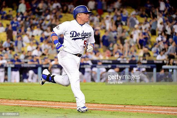 Carlos Ruiz of the Los Angeles Dodgers hits a RBi double in the eighth inning against the Chicago Cubs in game five of the National League Division...
