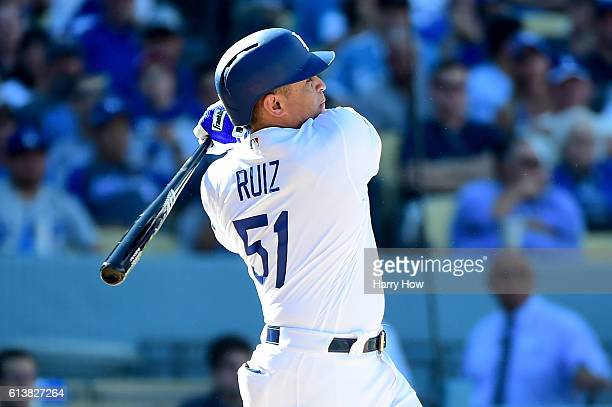 Carlos Ruiz of the Los Angeles Dodgers hits a tworun home run in the in fifth inning in game three of the National League Division Series against the...