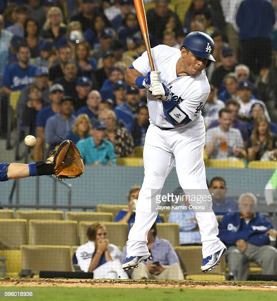 Carlos Ruiz of the Los Angeles Dodgers leaves his feet as he was hit by a pitch in the second inning of the game against the Chicago Cubs at Dodger...