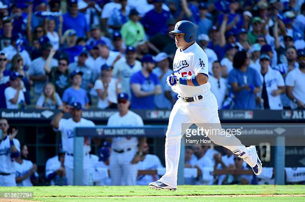 Carlos Ruiz of the Los Angeles Dodgers rounds the bases after he hits a tworun home run in the in fifth inning in game three of the National League...