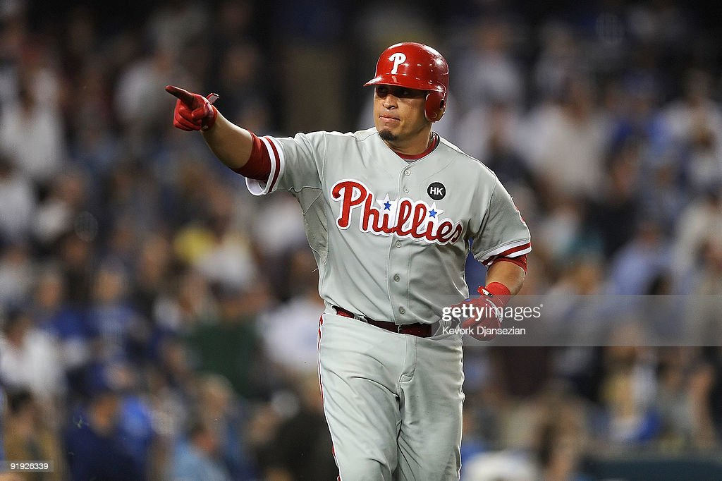 <a gi-track='captionPersonalityLinkClicked' href=/galleries/search?phrase=Carlos+Ruiz+-+Baseball+Player&family=editorial&specificpeople=216605 ng-click='$event.stopPropagation()'>Carlos Ruiz</a> #51 of the Philadelphia Phillies celebrates as he runs the bases afer hitting a three run home run in the fifth inning in Game One of the NLCS off of pitcher Clayton Kershaw (not pictured) of the Los Angeles Dodgers during the 2009 MLB Playoffs at Dodger Stadium on October 15, 2009 in Los Angeles, California.