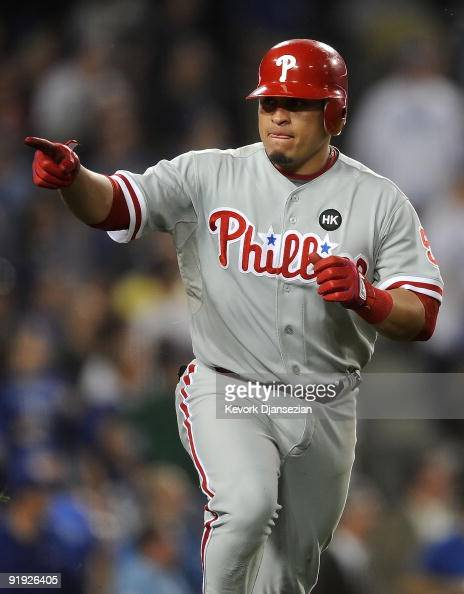Carlos Ruiz of the Philadelphia Phillies celebrates as he runs the bases afer hitting a three run home run in the fifth inning in Game One of the...