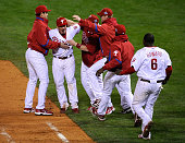 Carlos Ruiz of the Philadelphia Phillies celebrates his dribbler to score Eric Bruntlett to beat the Tampa Bay Rays 54 in game three of the 2008 MLB...