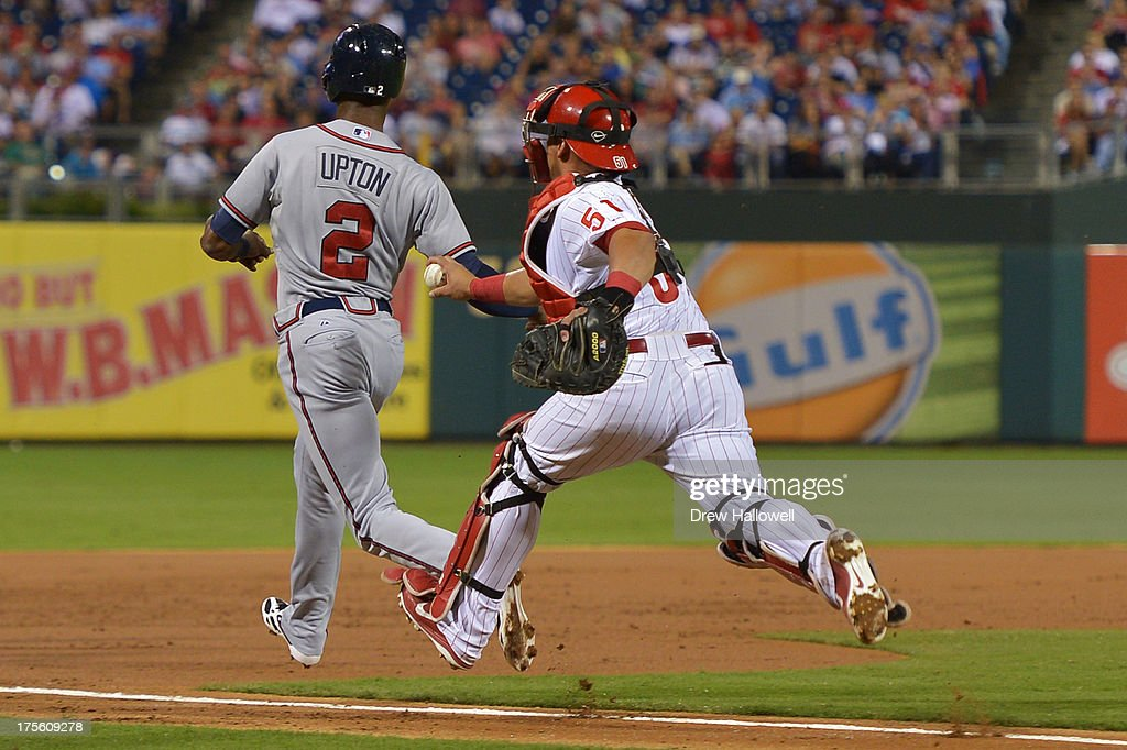 Carlos Ruiz #51 of the Philadelphia Phillies chases down <a gi-track='captionPersonalityLinkClicked' href=/galleries/search?phrase=B.J.+Upton&family=editorial&specificpeople=810704 ng-click='$event.stopPropagation()'>B.J. Upton</a> #2 of the Atlanta Braves in a rundown for an out in the second inning at Citizens Bank Park on August 4, 2013 in Philadelphia, Pennsylvania.