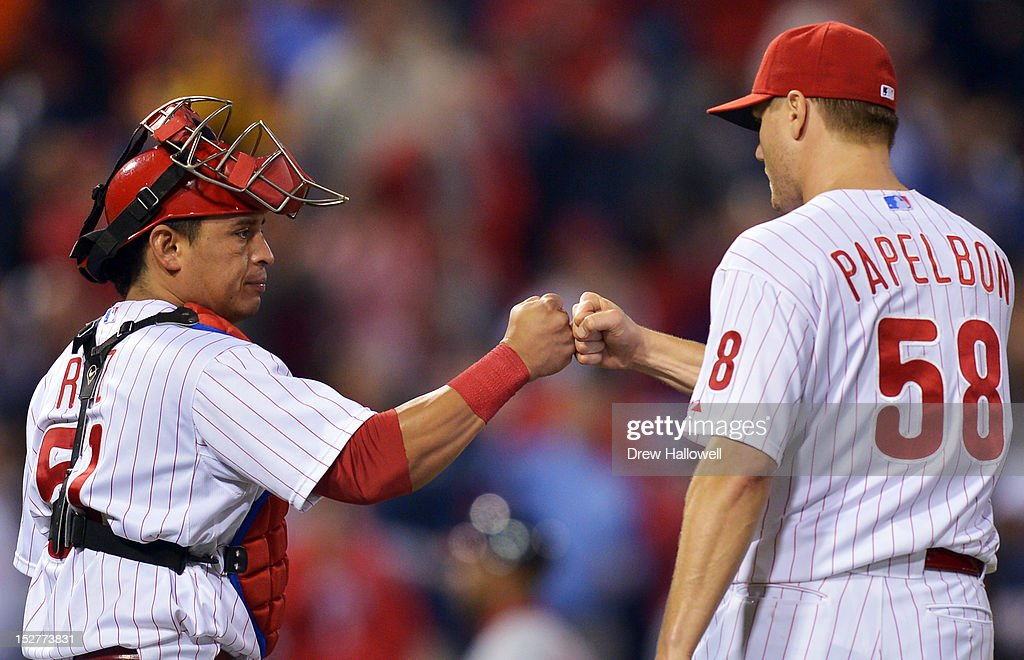 Carlos Ruiz #51 of the Philadelphia Phillies congratulates <a gi-track='captionPersonalityLinkClicked' href=/galleries/search?phrase=Jonathan+Papelbon&family=editorial&specificpeople=453535 ng-click='$event.stopPropagation()'>Jonathan Papelbon</a> #58 after beating the Washington Nationals 6-3 at Citizens Bank Park on September 25, 2012 in Philadelphia, Pennsylvania.