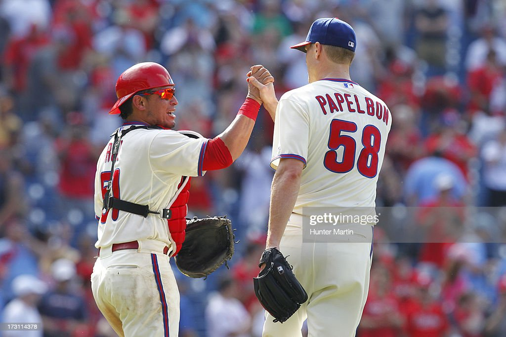 Carlos Ruiz #51 of the Philadelphia Phillies congratulates relief pitcher <a gi-track='captionPersonalityLinkClicked' href=/galleries/search?phrase=Jonathan+Papelbon&family=editorial&specificpeople=453535 ng-click='$event.stopPropagation()'>Jonathan Papelbon</a> #58 after closing out the game in the ninth inning against the Atlanta Braves at Citizens Bank Park on July 7, 2013 in Philadelphia, Pennsylvania. The Phillies won 7-3.