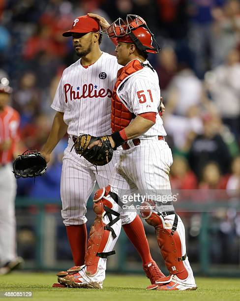 Carlos Ruiz of the Philadelphia Phillies congratulates relief pitcher Antonio Bastardo after the Phillies beat the Washington Nationals 72 at...