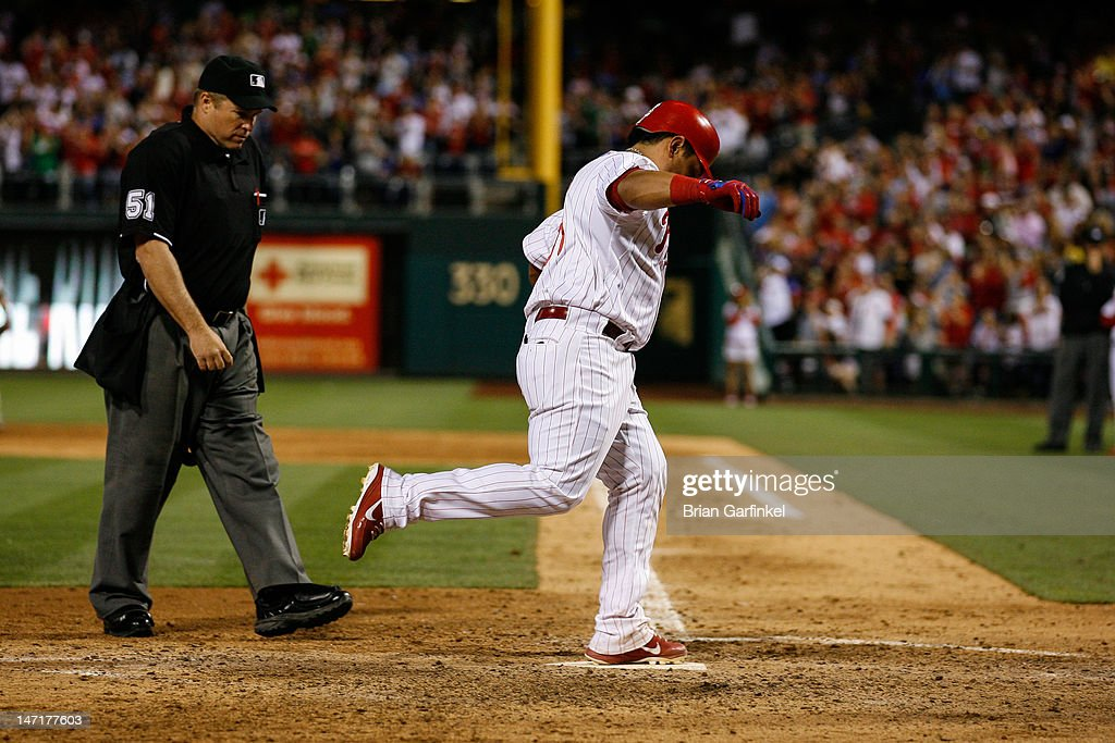 <a gi-track='captionPersonalityLinkClicked' href=/galleries/search?phrase=Carlos+Ruiz+-+Baseball+Player&family=editorial&specificpeople=216605 ng-click='$event.stopPropagation()'>Carlos Ruiz</a> #51 of the Philadelphia Phillies crosses home after hitting a solo home run in the eighth inning of the game against the Pittsburgh Pirates at Citizens Bank Park on June 26, 2012 in Philadelphia, Pennsylvania. The Phillies won 5-4.