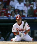 Carlos Ruiz of the Philadelphia Phillies falls to his knees as he reacts after getting hit by a pitch against the Washington Nationals at Citizens...