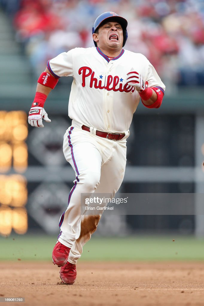Carlos Ruiz #51 of the Philadelphia Phillies grimaces as he advances to third base in the second inning of the game against the Cincinnati Reds at Citizens Bank Park on May 19, 2013 in Philadelphia, Pennsylvania.