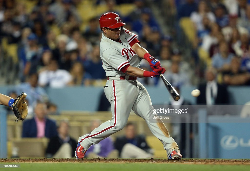 Carlos Ruiz #51 of the Philadelphia Phillies hits a double that scores two runs in the ninth inning against the Los Angeles Dodgers at Dodger Stadium on April 24, 2014 in Los Angeles, California.