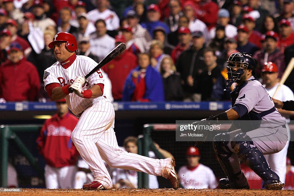 Carlos Ruiz #51 of the Philadelphia Phillies hits a dribbler to score Eric Bruntlett #4 to beat the Tampa Bay Rays 5-4 in game three of the 2008 MLB World Series on October 25, 2008 at Citizens Bank Park in Philadelphia, Pennsylvania.
