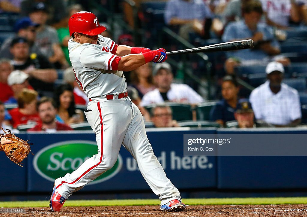 Carlos Ruiz #51 of the Philadelphia Phillies hits a RBI double in the eighth inning against the Atlanta Braves at Turner Field on September 2, 2014 in Atlanta, Georgia.