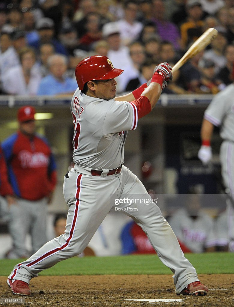 Carlos Ruiz #51 of the Philadelphia Phillies hits a single during the seventh inning of a baseball game against the San Diego Padres at Petco Park on June 26, 2013 in San Diego, California.