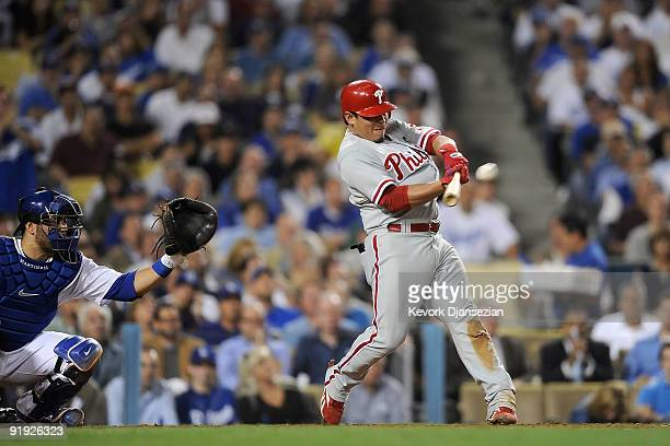 Carlos Ruiz of the Philadelphia Phillies hits a three run home run in the fifth inning in Game One of the NLCS off of pitcher Clayton Kershaw of the...