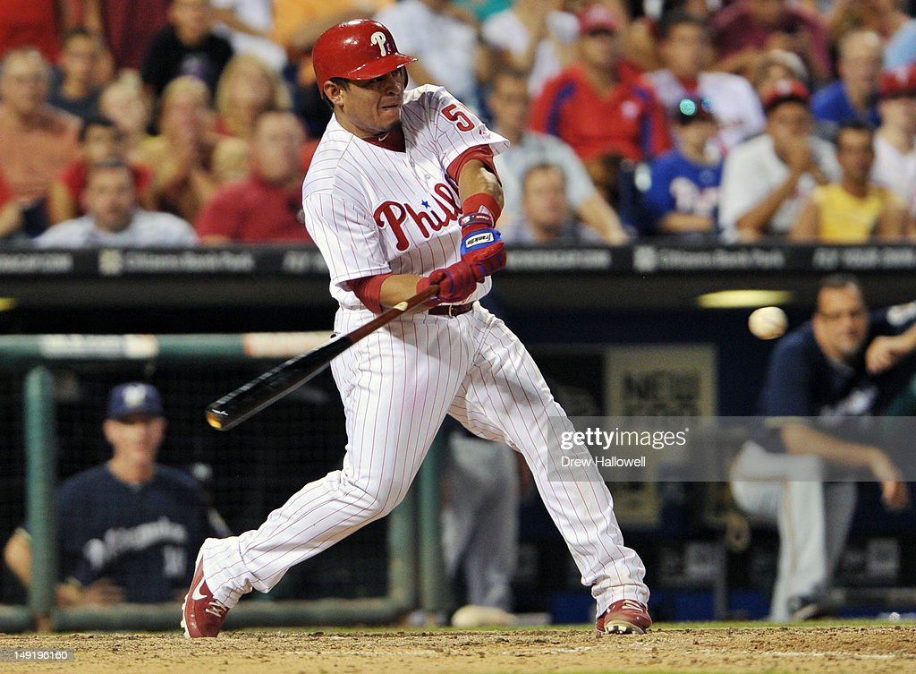 Carlos Ruiz #51 of the Philadelphia Phillies hits a three-run double in the eighth inning during the game against the Milwaukee Brewers at Citizens Bank Park on July 24, 2012 in Philadelphia, Pennsylvania. The Phillies won 7-6.