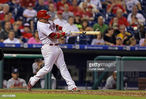 Carlos Ruiz of the Philadelphia Phillies hits a tworun single in the fourth inning during a game against the Atlanta Braves at Citizens Bank Park on...