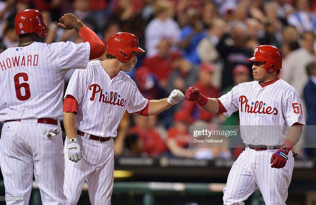 Carlos Ruiz #51 of the Philadelphia Phillies is congratulated by teammates <a gi-track='captionPersonalityLinkClicked' href=/galleries/search?phrase=Chase+Utley&family=editorial&specificpeople=161391 ng-click='$event.stopPropagation()'>Chase Utley</a> #26 and <a gi-track='captionPersonalityLinkClicked' href=/galleries/search?phrase=Ryan+Howard&family=editorial&specificpeople=551402 ng-click='$event.stopPropagation()'>Ryan Howard</a> #6 after hitting a three run home rune during the game against the Washington Nationals at Citizens Bank Park on September 25, 2012 in Philadelphia, Pennsylvania.