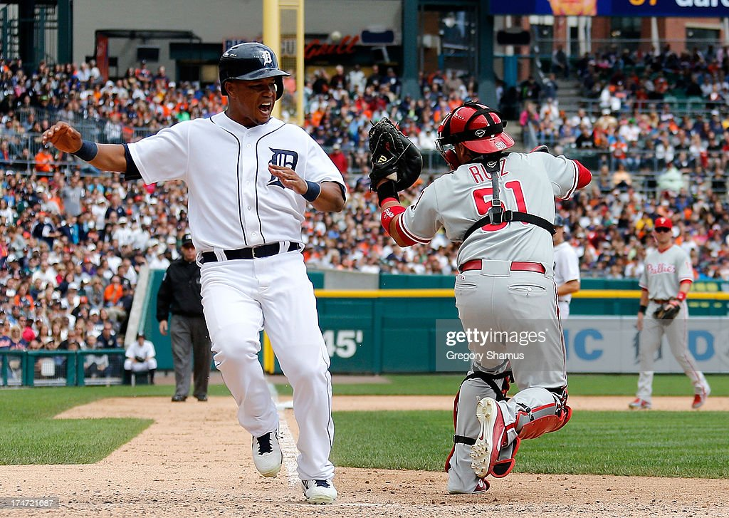 Carlos Ruiz #51 of the Philadelphia Phillies is pulled off the plate on a force out play by a bad throw in the sixth inning next to <a gi-track='captionPersonalityLinkClicked' href=/galleries/search?phrase=Ramon+Santiago&family=editorial&specificpeople=2984417 ng-click='$event.stopPropagation()'>Ramon Santiago</a> #39 of the Detroit Tigers at Comerica Park on July 28, 2013 in Detroit, Michigan. Santiago was called safe on the play.