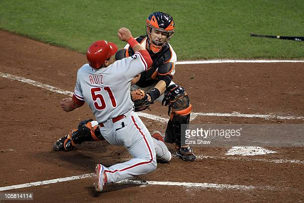 Carlos Ruiz of the Philadelphia Phillies is tagged out at the plate by catcher Buster Posey of the San Francisco Giants in the fifth inning of Game...