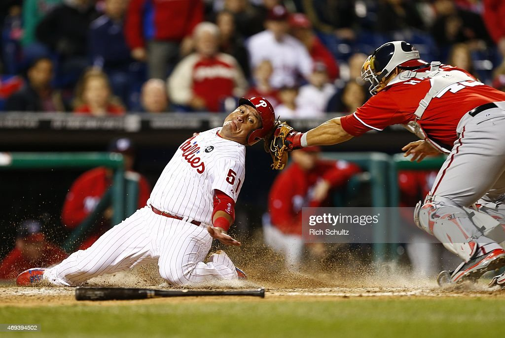 <a gi-track='captionPersonalityLinkClicked' href=/galleries/search?phrase=Carlos+Ruiz+-+Baseball+Player&family=editorial&specificpeople=216605 ng-click='$event.stopPropagation()'>Carlos Ruiz</a> #51 of the Philadelphia Phillies is tagged out by catcher <a gi-track='captionPersonalityLinkClicked' href=/galleries/search?phrase=Wilson+Ramos&family=editorial&specificpeople=4866956 ng-click='$event.stopPropagation()'>Wilson Ramos</a> #40 of the Washington Nationals while trying to score on a fielders choice hit by Odubel Herrera #37 during the eighth inning of a game at Citizens Bank Park on April 11, 2015 in Philadelphia, Pennsylvania.