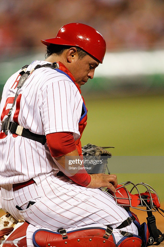Carlos Ruiz #51 of the Philadelphia Phillies looks down after being hit with a pitch during the game against the Colorado Rockies at Citizens Bank Park on June 20, 2012 in Philadelphia, Pennsylvania. The Phillies won 7-6.