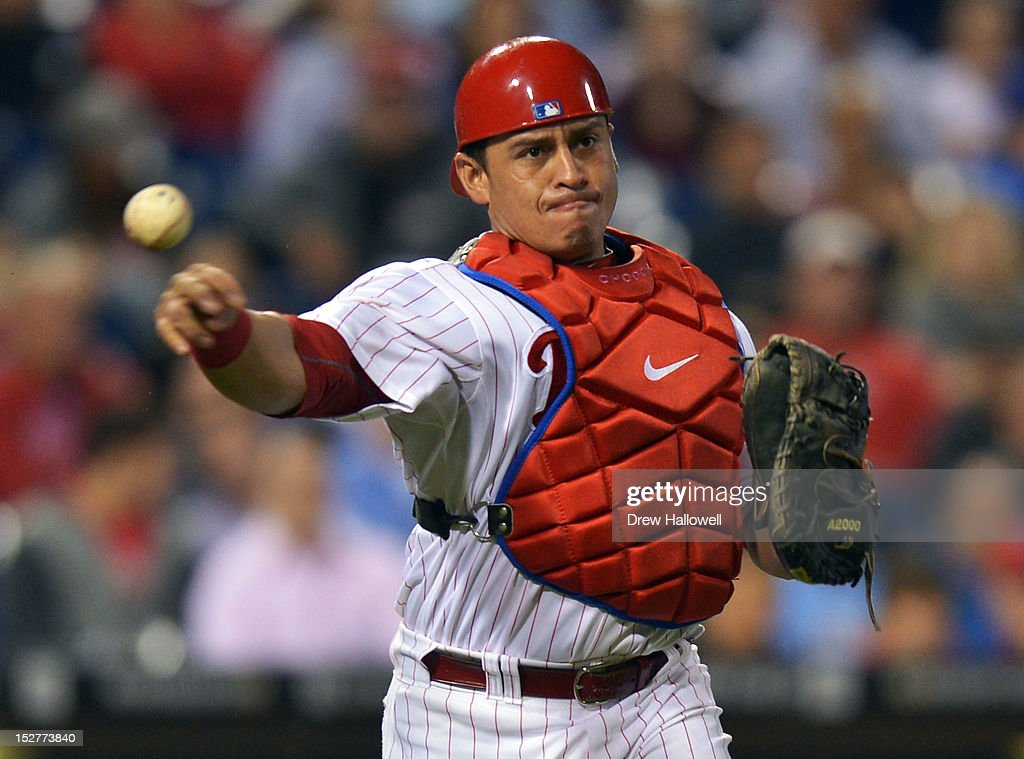 Carlos Ruiz #51 of the Philadelphia Phillies makes a throw to first base during the game against the Washington Nationals at Citizens Bank Park on September 25, 2012 in Philadelphia, Pennsylvania. The Phillies won 6-3.