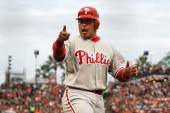 Carlos Ruiz of the Philadelphia Phillies reacts after scoring in the third inning against the San Francisco Giants in Game Five of the NLCS during...
