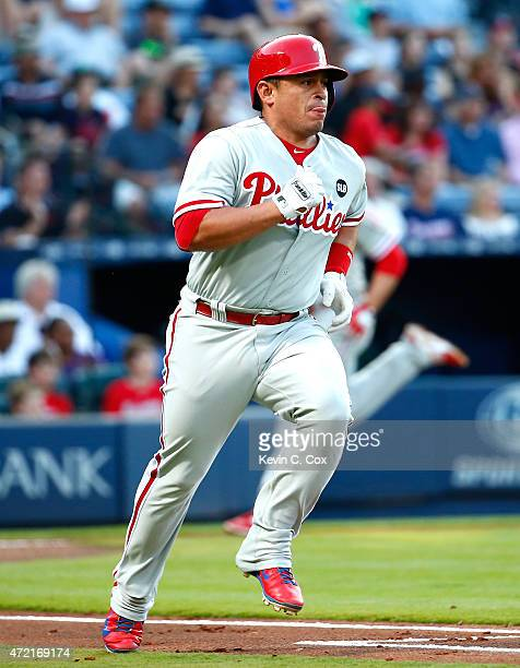 Carlos Ruiz of the Philadelphia Phillies runs to first base after hitting a 2RBI single in the first inning against the Atlanta Braves at Turner...