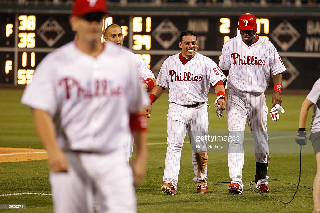 Carlos Ruiz #51 of the Philadelphia Phillies smiles after the game against the Colorado Rockies at Citizens Bank Park on June 20, 2012 in Philadelphia, Pennsylvania. The Phillies won 7-6.