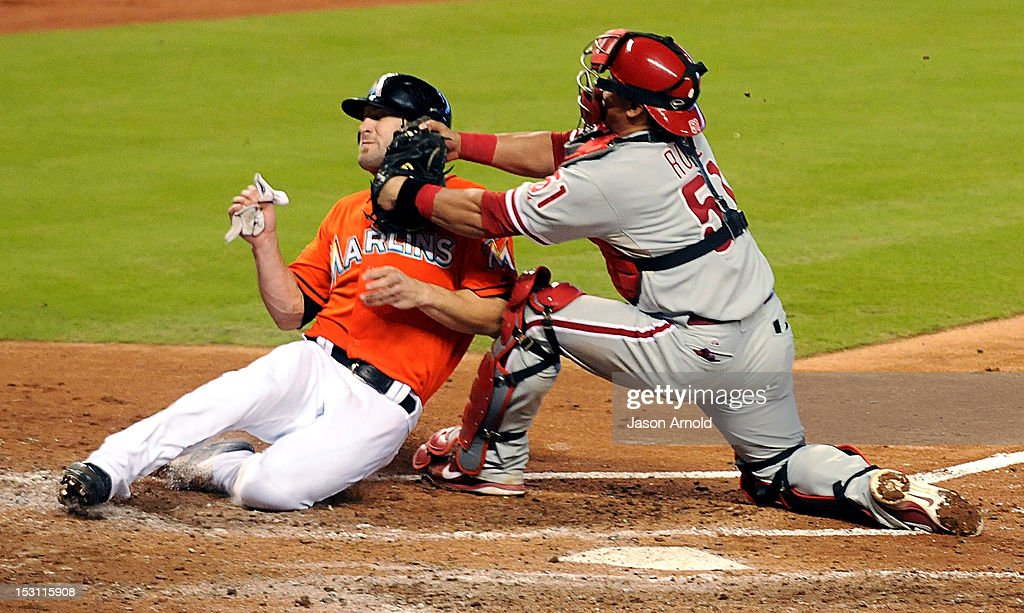 Carlos Ruiz #51 (R) of the Philadelphia Phillies tags out <a gi-track='captionPersonalityLinkClicked' href=/galleries/search?phrase=Bryan+Petersen+-+Baseball+Player&family=editorial&specificpeople=4963930 ng-click='$event.stopPropagation()'>Bryan Petersen</a> #11 of the Miami Marlins at Marlins Park on September 30, 2012 in Miami, Florida.