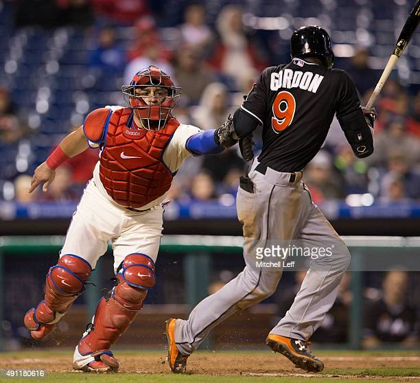Carlos Ruiz of the Philadelphia Phillies tags out Dee Gordon of the Miami Marlins in the top of the ninth inning on October 3 2015 at Citizens Bank...