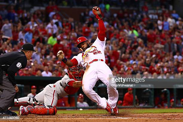 Carlos Ruiz of the Philadelphia Phillies tags out Jason Heyward of the St Louis Cardinals to save a run in the second inning at Busch Stadium on...