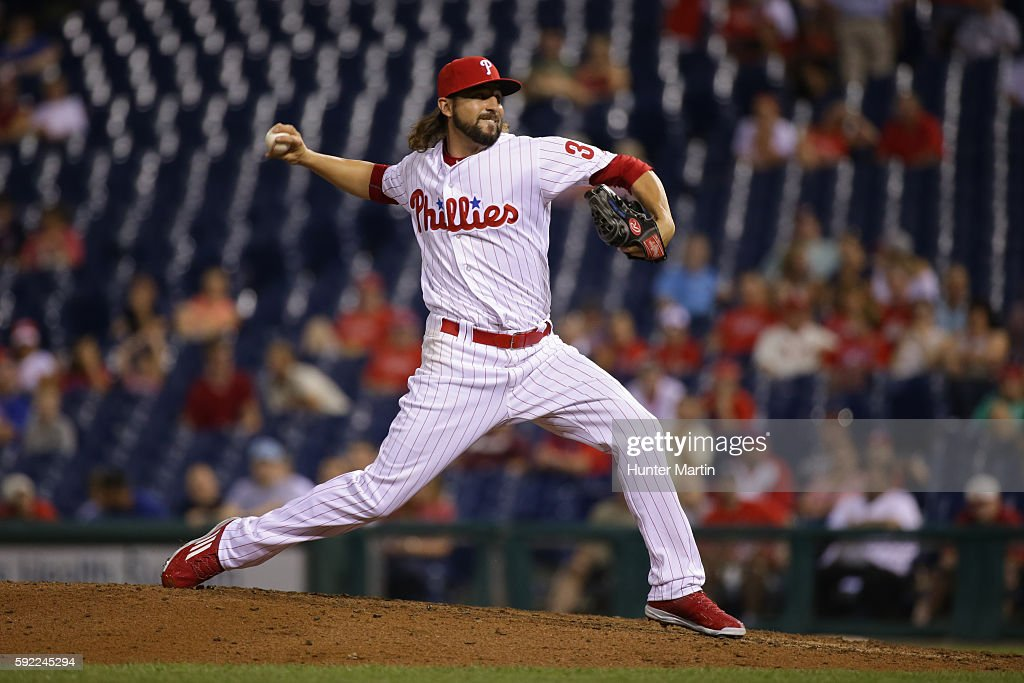 Carlos Ruiz of the Philadelphia Phillies throws a pitch in the 11th inning during a game against the St Louis Cardinals at Citizens Bank Park on...