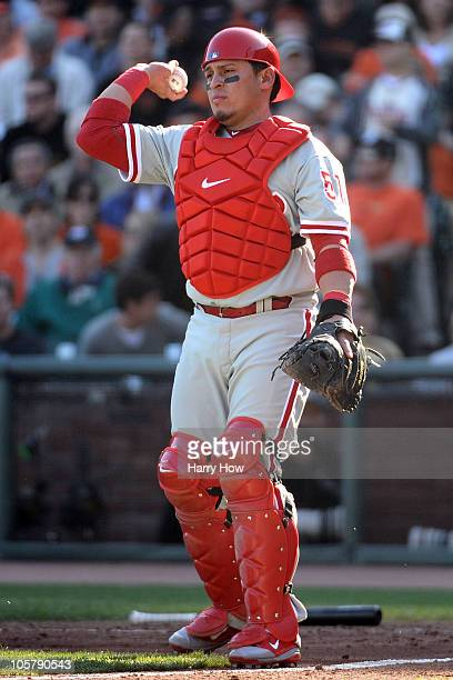 Carlos Ruiz of the Philadelphia Phillies throws the ball back to the pitcher against the San Francisco Giants in Game Three of the NLCS during the...