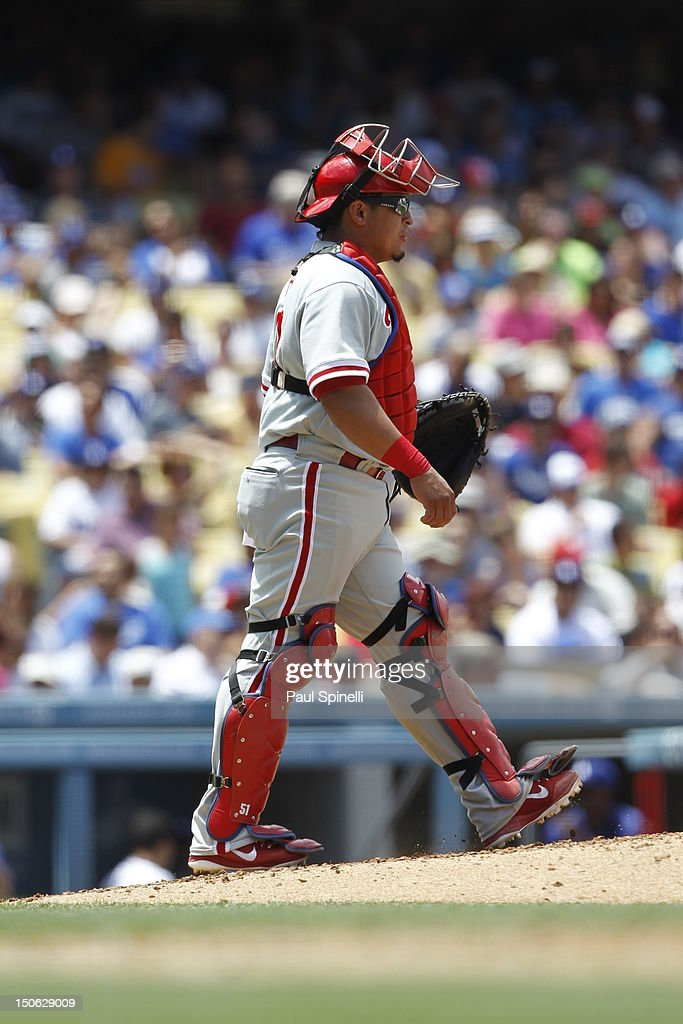 Carlos Ruiz #51 of the Philadelphia Phillies walks to the pitchers mound during the game against the Los Angeles Dodgers on Wednesday, July 18, 2012 at Dodger Stadium in Los Angeles, California. The Dodgers won the game 5-3.