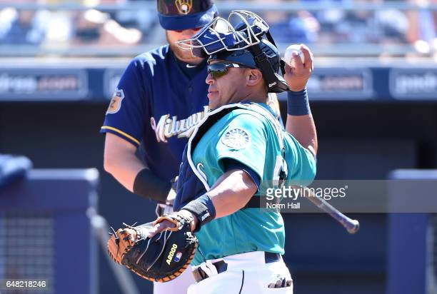 Carlos Ruiz of the Seattle Mariners throws the ball back to the pitcher against the Milwaukee Brewers at Peoria Stadium on March 2 2017 in Peoria...
