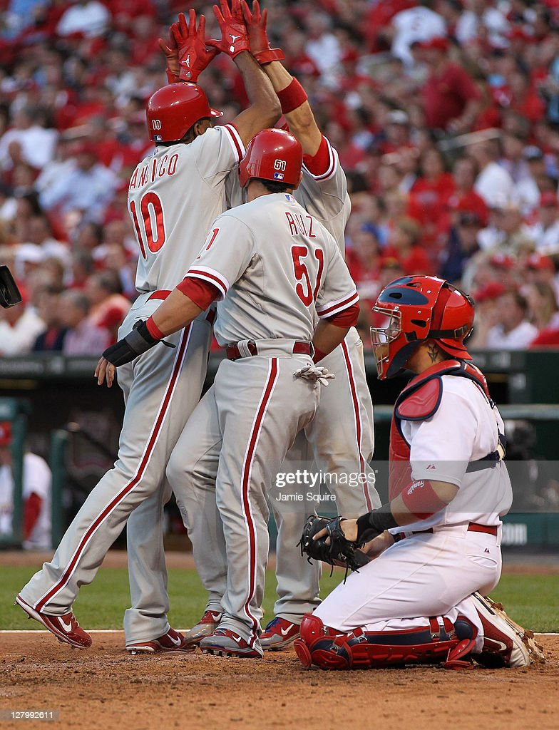 Carlos Ruiz Shane Victorino and Ben Francisco of the Philadelphia Phillies celebrates after Francisco's threerun home run against the St Louis...