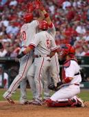 Carlos Ruiz Shane Victorino and Ben Francisco of the Philadelphia Phillies celebrates after Francisco's threerun home run against the St Louis...