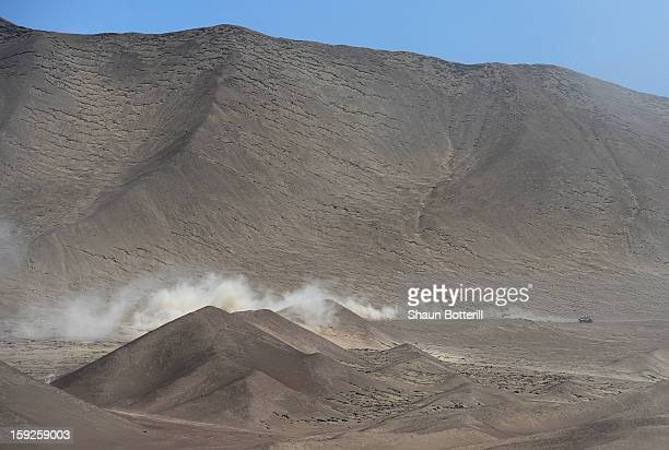 Carlos Sainz and codriver Timo Gottschalk of team Buggy compete in stage 6 from Arica to Calama during the 2013 Dakar Rally on January 10 2013 in...