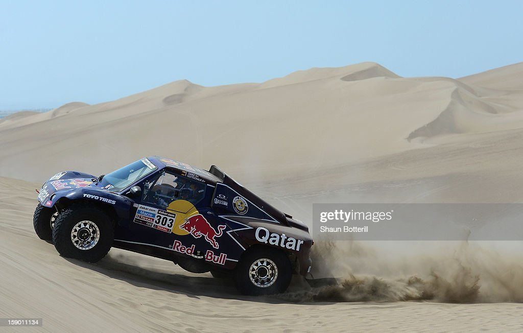 <a gi-track='captionPersonalityLinkClicked' href=/galleries/search?phrase=Carlos+Sainz+-+Born+1962&family=editorial&specificpeople=14996439 ng-click='$event.stopPropagation()'>Carlos Sainz</a> and co-pilot Timo Gottschalk of team Buggy compete during the special stage of day one of the of the 2013 Dakar Rally on January 5, 2013 in Pisco, Peru.